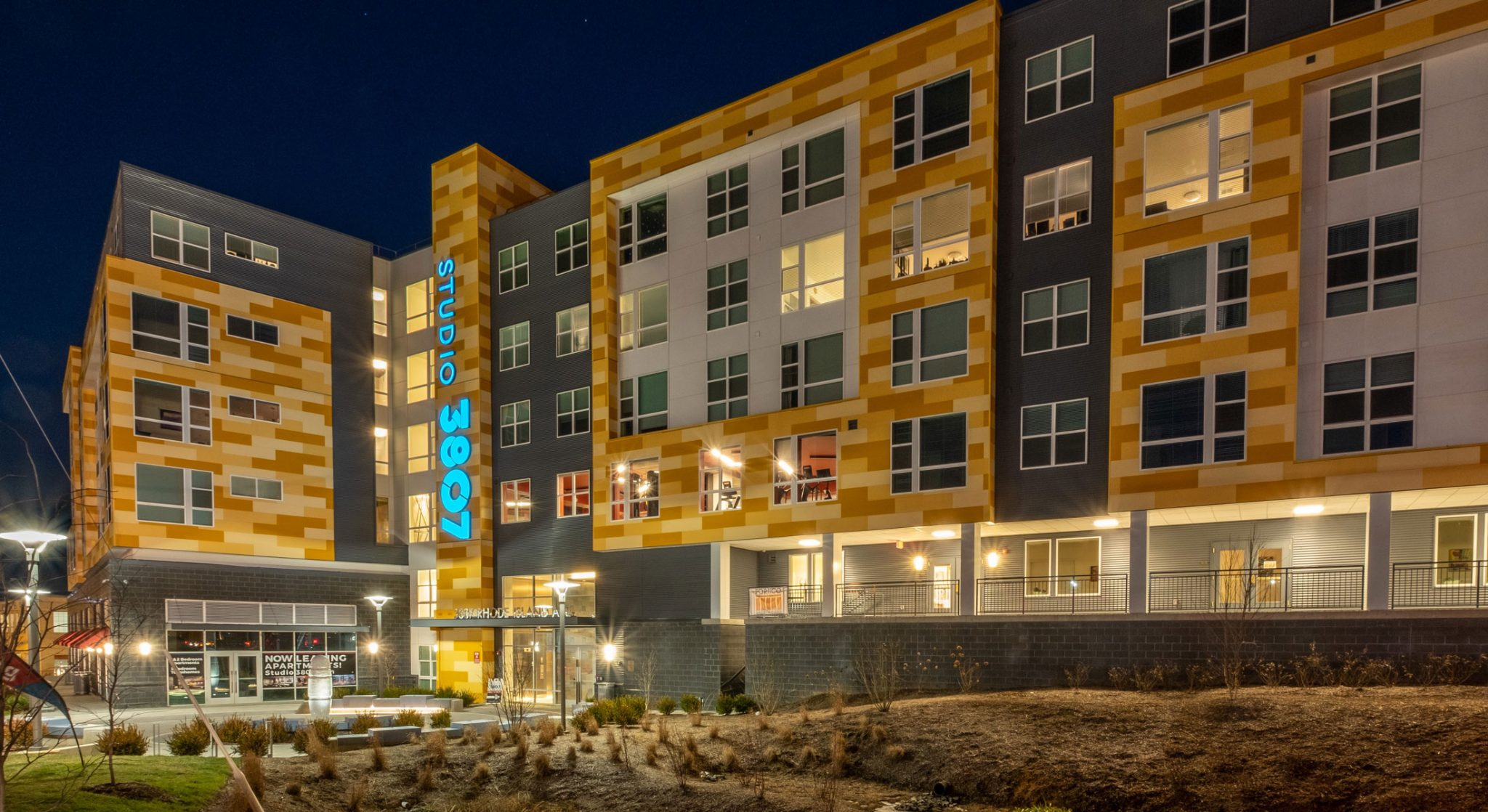Studio 3807 Exterior apartment complex that includes grilling kitchens and fire pits