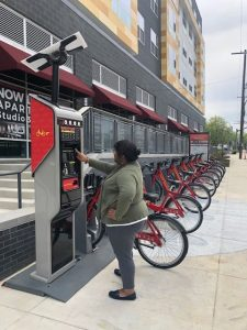 A woman using Capital BikeShare bicycle rental